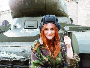 Tank lady wearing a Russian Tank Helmet